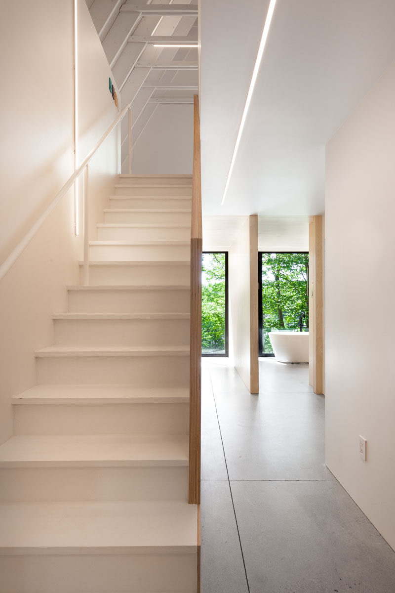 These white stairs lead to an attic play space.