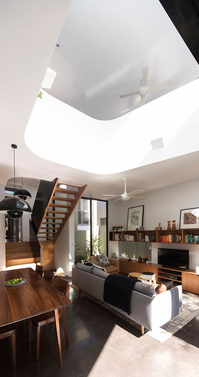 This house extension has a void in the ceiling to reveal the second floor, and to aid in the air ventilation throughout the home.