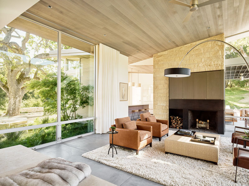 Large floor-to-ceiling windows contribute natural light to the living room, that is home to an interior palette of cedar-clad ceilings, oil-rubbed steel, and exposed concrete floors.
