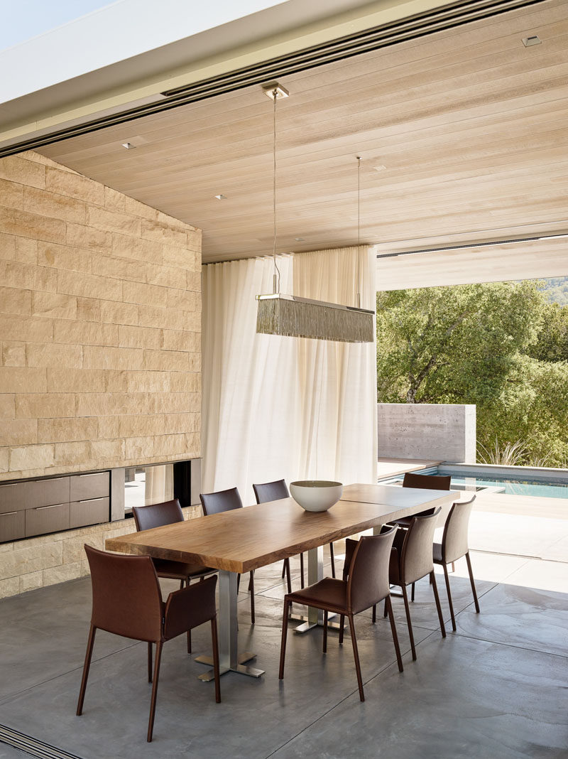 This dining room opens on both sides to provide access to outdoor entertaining areas.