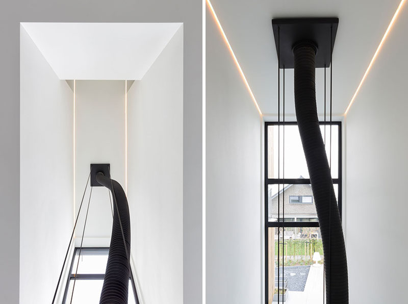These photos show how a hanging fireplace can be connected and vented to the ceiling above.