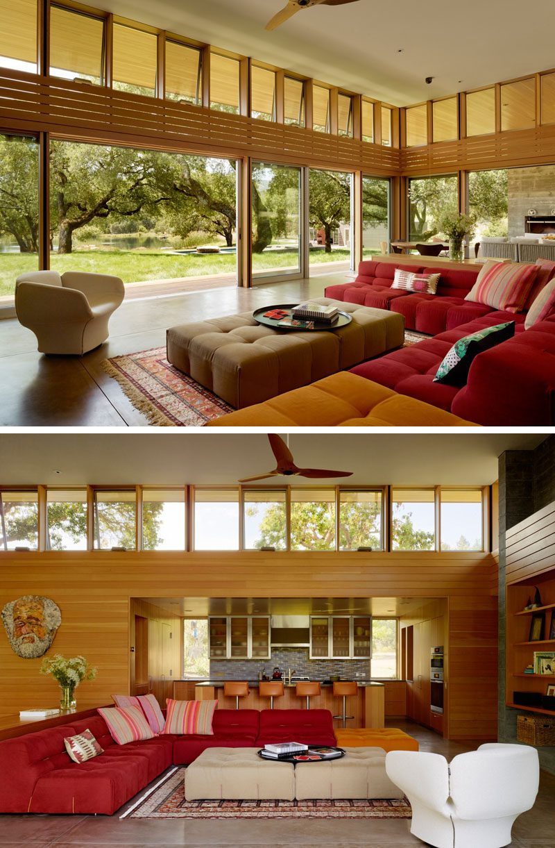 This living room, that opens to the backyard, is full of comfortable colorful sofas.