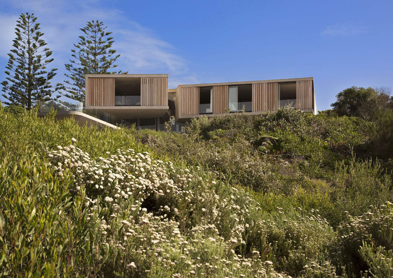 This family home in South Africa takes advantage of the sloping site and water views.