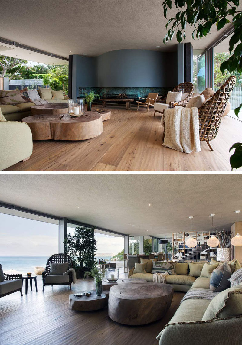 This living area has a curved fireplace, with plenty of seating and large natural wood coffee tables. The living room also opens up onto the balcony overlooking the pool below.