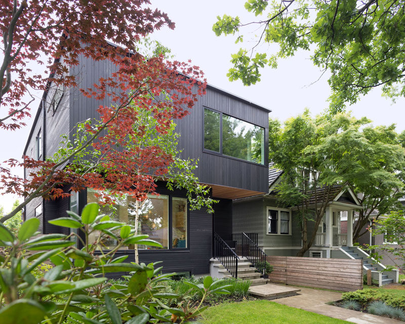 This contemporary home with black cladding can be found in Vancouver, Canada.
