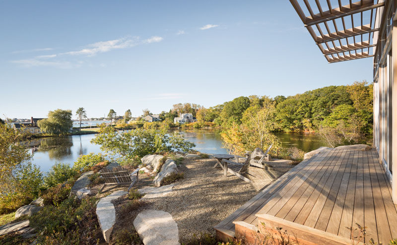 This home sits on top of a granite rock and has views of a lily pond and the Atlantic Ocean.
