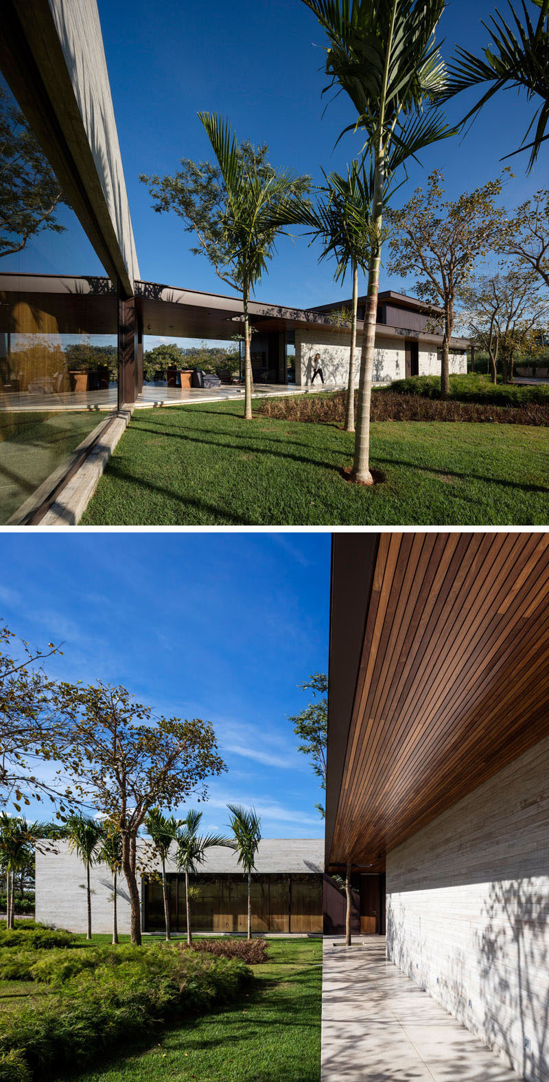 This home in Brazil has a covered walkway on the exterior of the home.