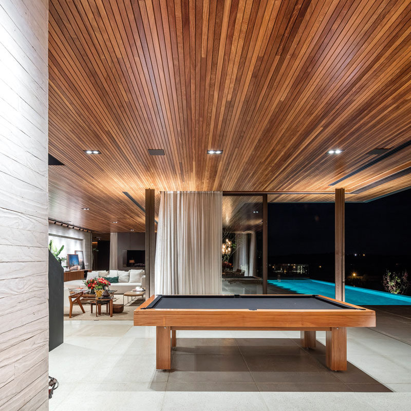 Around the corner from the living room in this home, is a dedicated spot for a pool table. Perfect for when you want to have a game after cooling off in the swimming pool.
