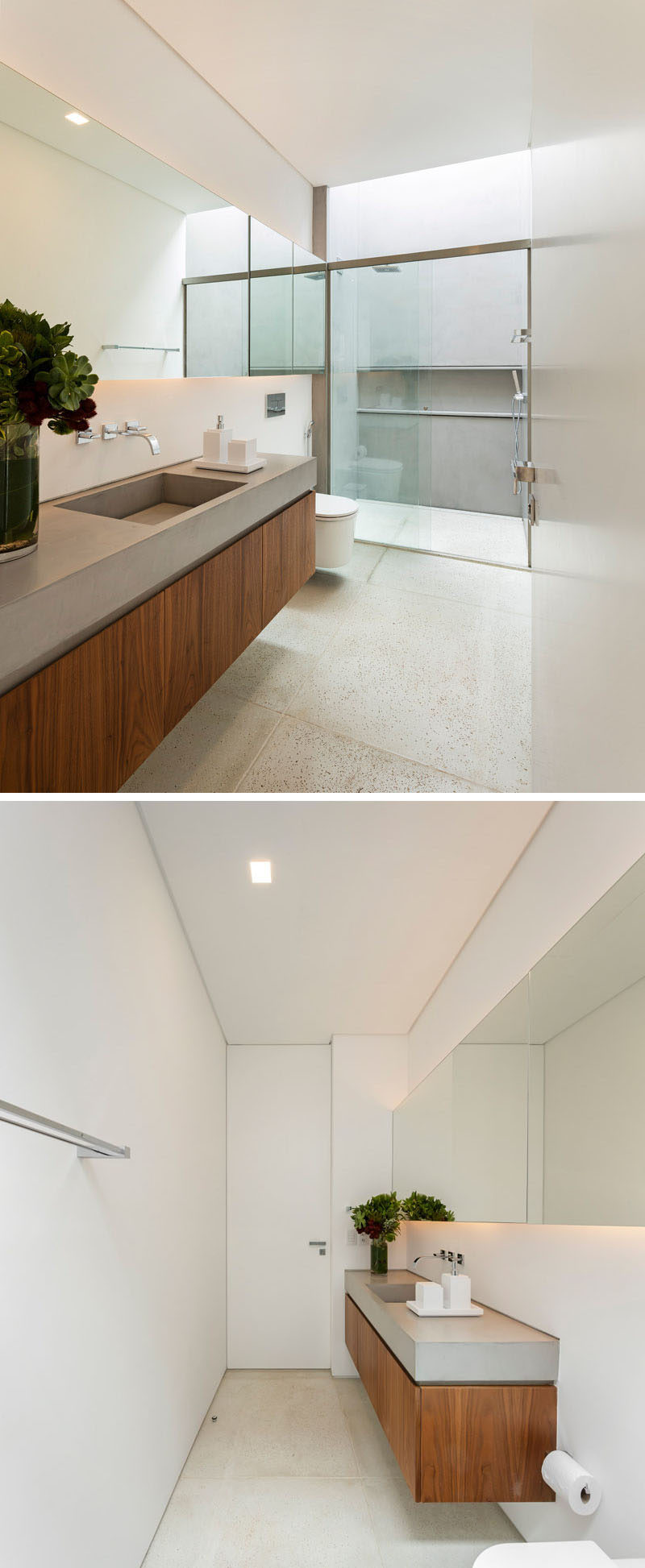 In this ensuite bathroom, there's a vanity with a single sink, and a walk-in shower with lots of light from a skylight.