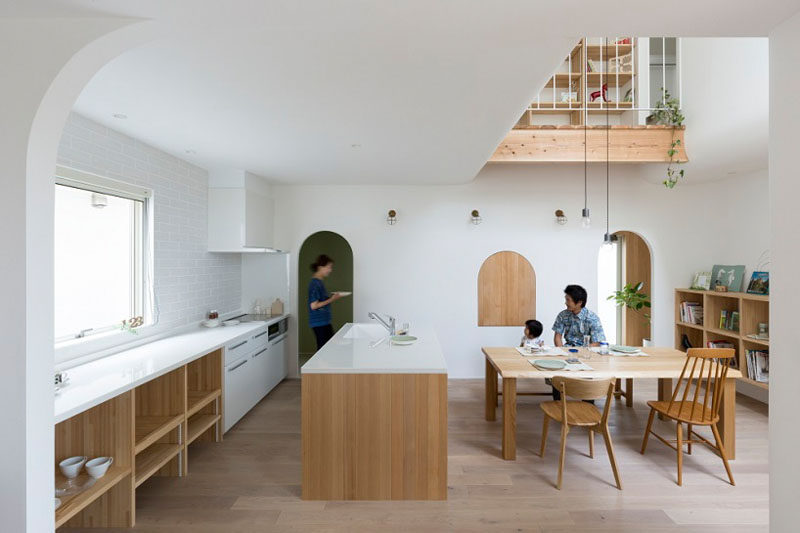 This Japanese Home With A Wood And White Interior, Is Filled With Arched Doorways