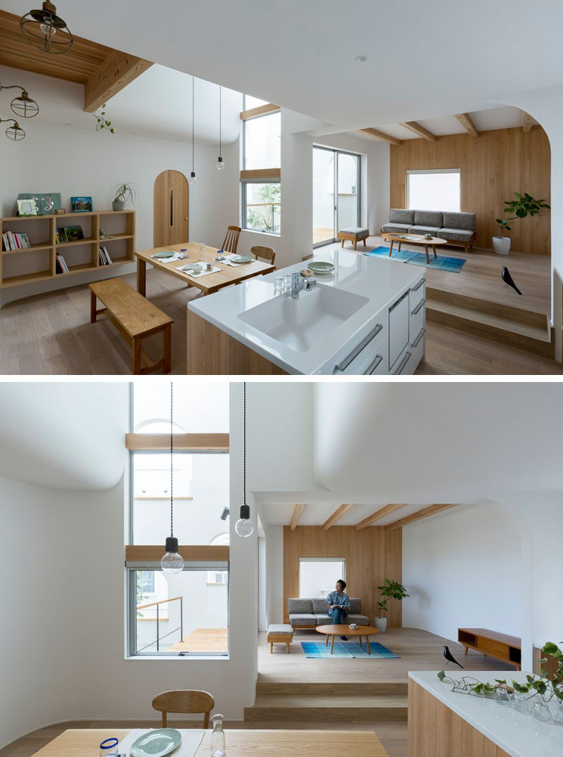 The kitchen and dining room of this home are located on the same level, with a small living room raised slightly to separate it from the rest of the space.