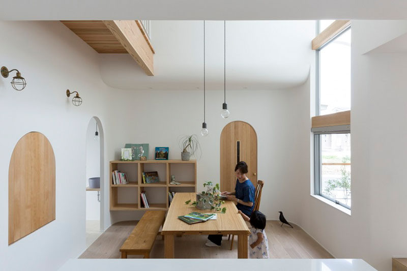 The wooden arches have been designed to match the wooden furniture and shelving found throughout this home, keeping the color palette very simple and minimalist.