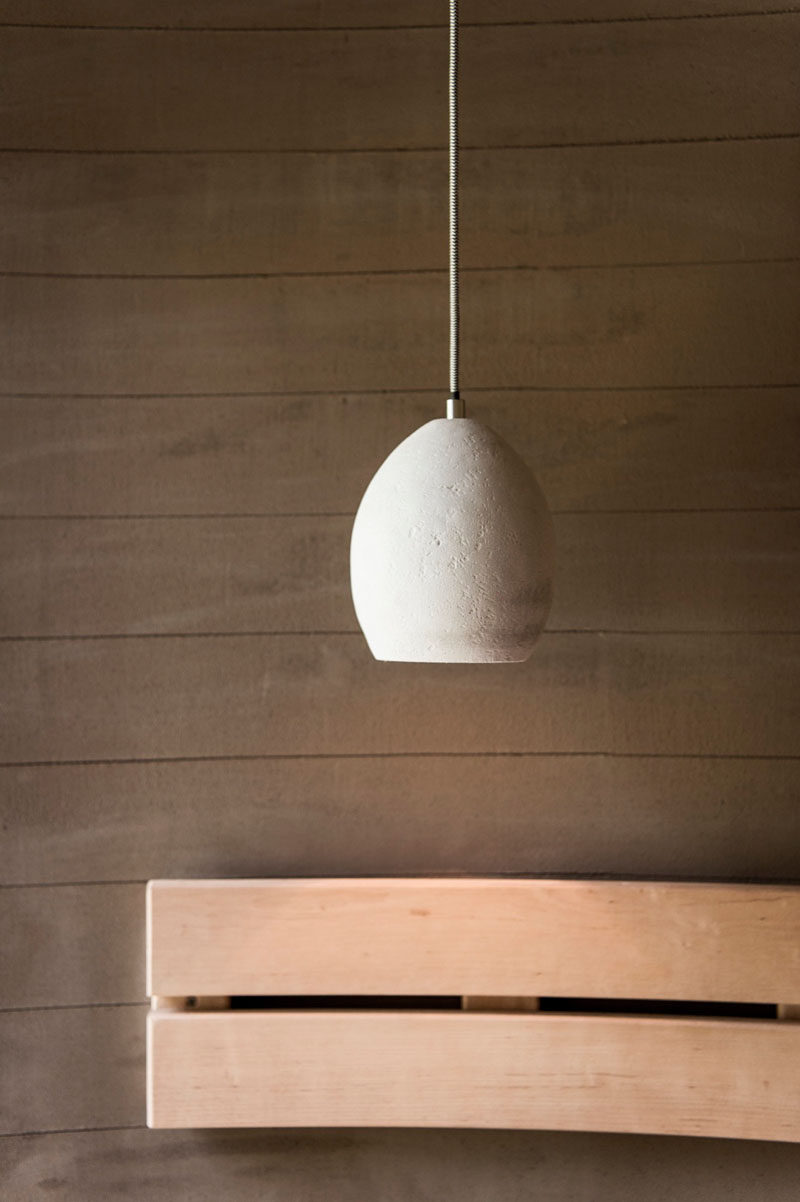 Contemporary lighting features in this sauna in Italy.