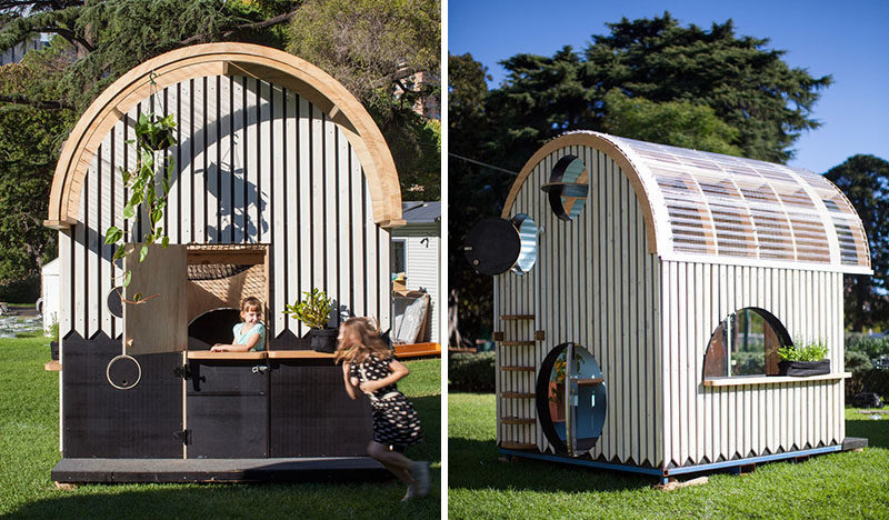 This modern playhouse (or cubbyhouse) has decorative siding and a curved roof with windows. Inside, there's bench seating, storage and loft with a net for relaxing.