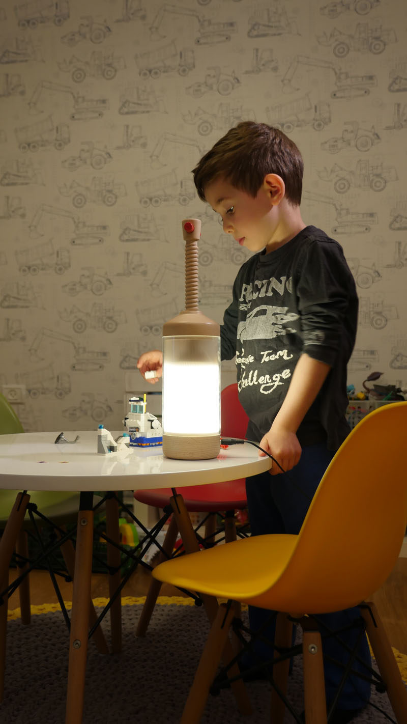 London-based duo Omer & Ortal Menashri, have designed a lamp that allows you to adjust the amount of light it shows by quickly pushing the light down, or by using the screw mechanism, depending on the design.
