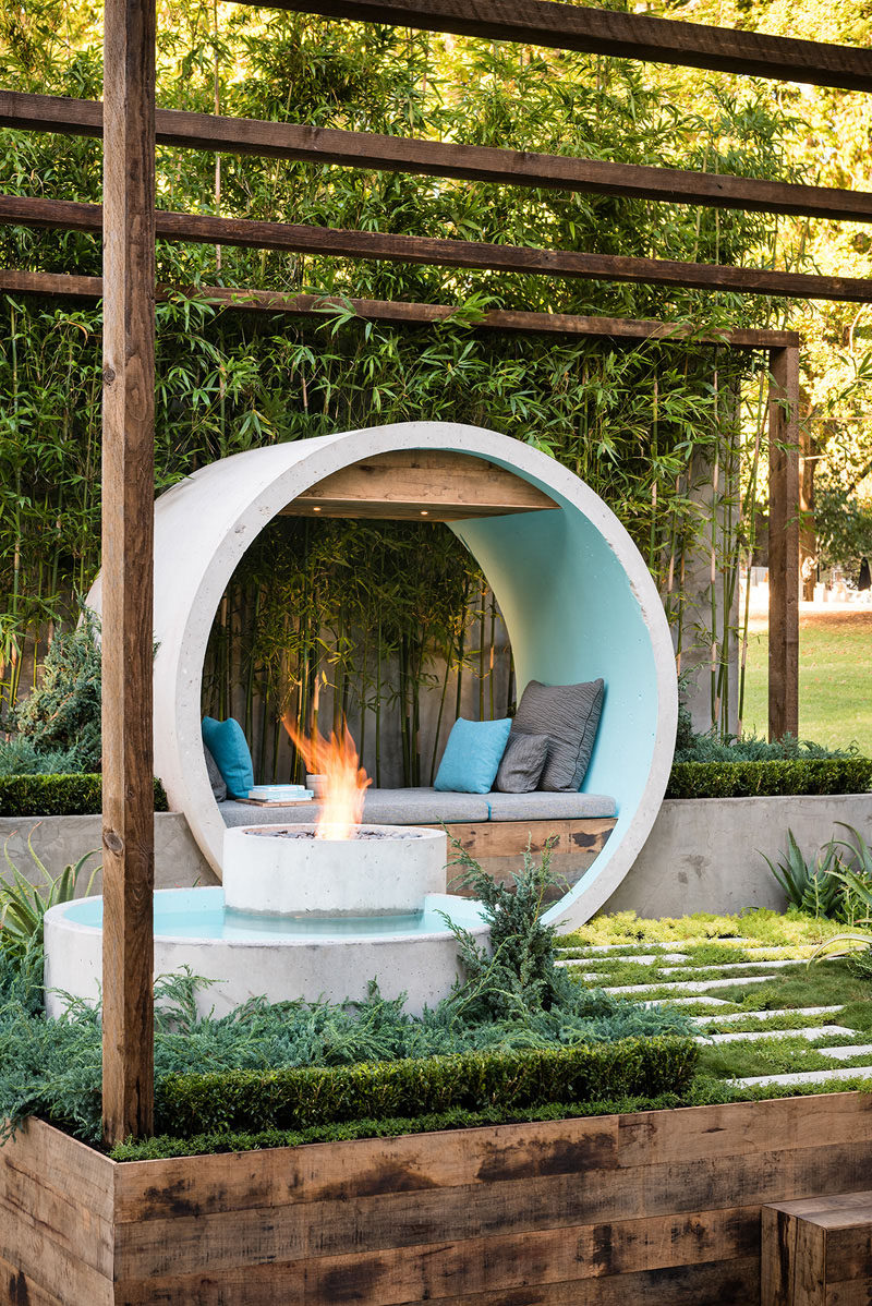 This landscaping idea uses a number of concrete pipes to created a meditation moon gate / day bed, a reflective water feature, and a fire pit.