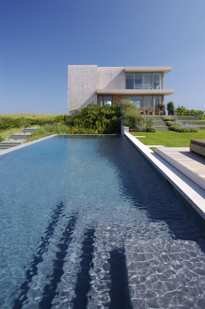 This house in Bridgehampton, New York, has a swimming pool surrounded by a peaceful landscape.