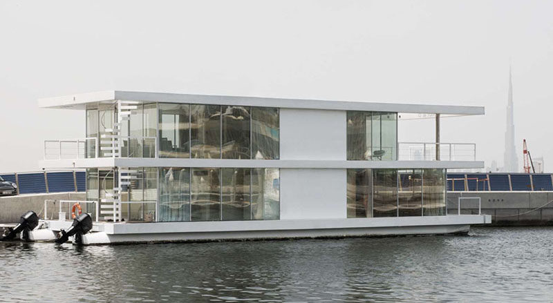 11 Awesome Examples Of Modern House Boats // This houseboat is made primarily from glass and stainless steel to make it more visually intriguing as it floats through the water.