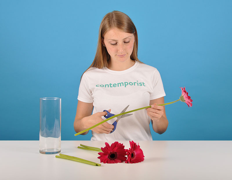 9 Ways To Keep Your Cut Flowers Fresh // Trim The Ends --- Cut the bottom half inch off the ends of the flowers at an angle to create more surface area for the water to be absorbed by. This will allow your flowers to suck up as much water as they can and prevent them from wilting and turning brown prematurely.