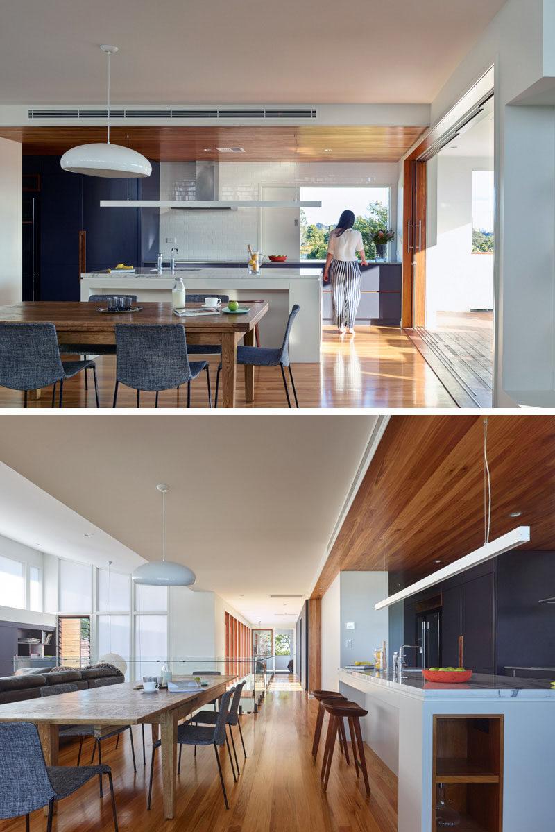 Kitchen Island Lighting Idea - Use One Long Light Instead Of Multiple Pendant Lights