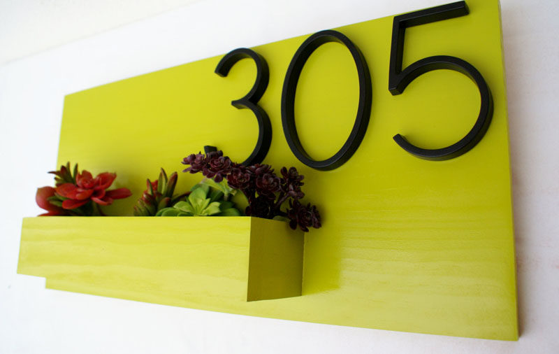 House numbers don't have to be just attached to the side of your house, you can also incorporate them into a planter design. #ModernHouseNumber #HouseNumbers #HomeDecor