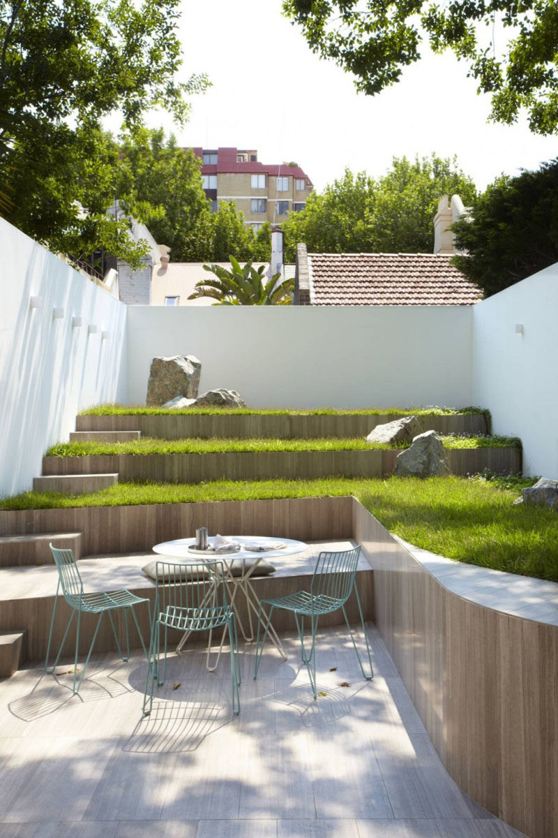 13 Multi-Level Backyards To Get You Inspired For A Summer Backyard Makeover // It may be a small yard but the various levels allow for more green space and make it appear larger.