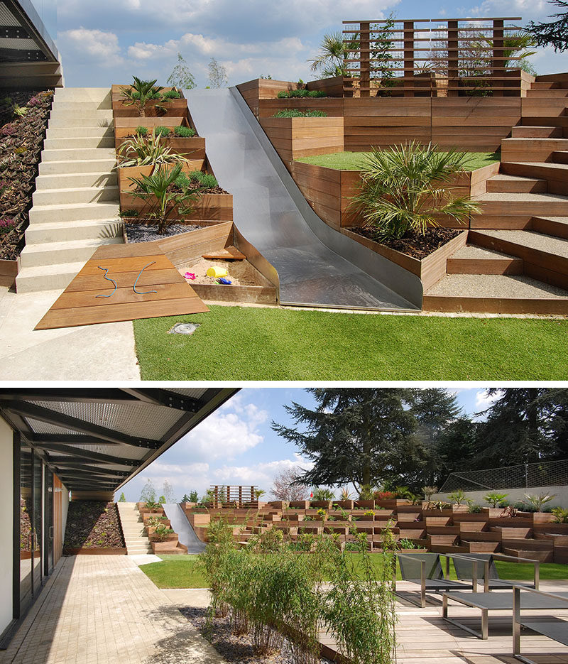 13 Multi-Level Backyards To Get You Inspired For A Summer Backyard Makeover // Triangular terraced planters create a multilevel yard complete with a slide and sandbox for the kids.