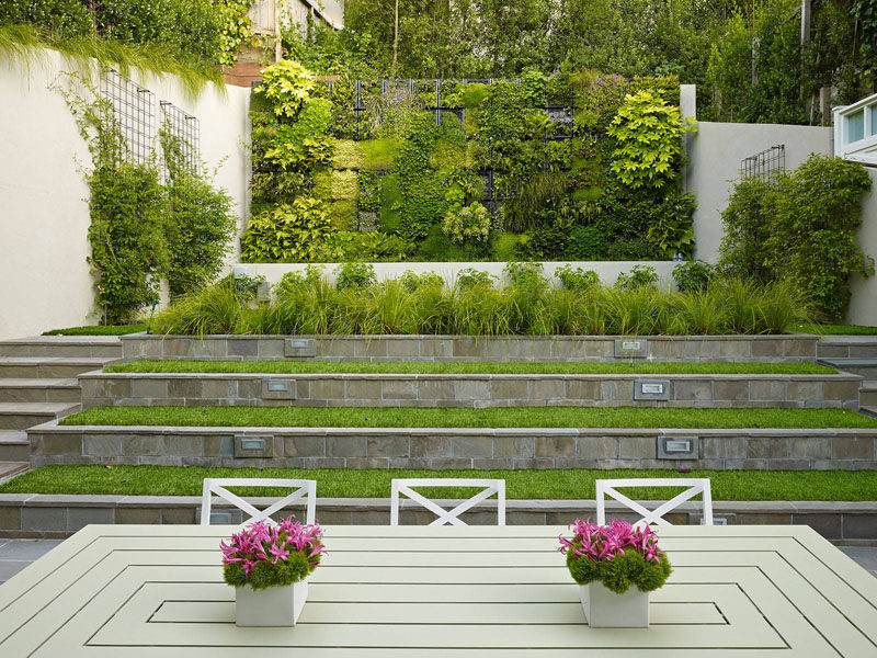 13 Multi-Level Backyards To Get You Inspired For A Summer Backyard Makeover // ots of green in the various levels of this backyard help it feel bigger than it actually is.