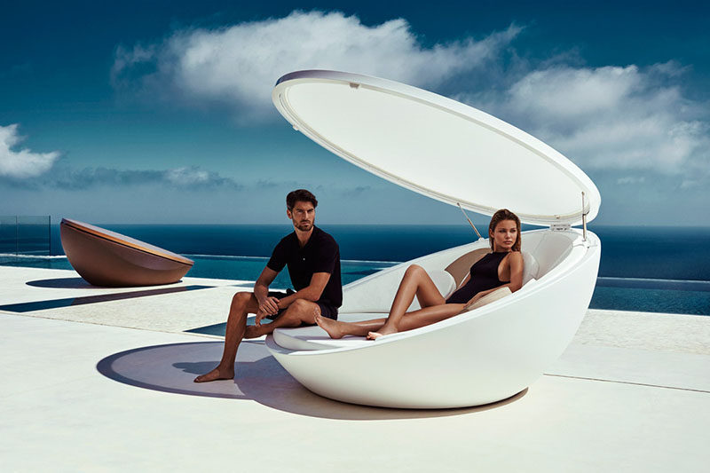 12 Outdoor Furniture Designs That Add A Sculptural Element To Your Backyard // Inspired by a shell, this daybed has a swivel feature so you spin around and take in everything around you. This lid also helps to provide shade on a hot day.