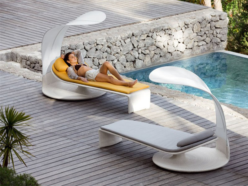 12 Outdoor Furniture Designs That Add A Sculptural Element To Your Backyard // Drift off to sleep in this sun lounge that has a shade cover that can swivel, allowing you enhance your sun-worshiping moments.