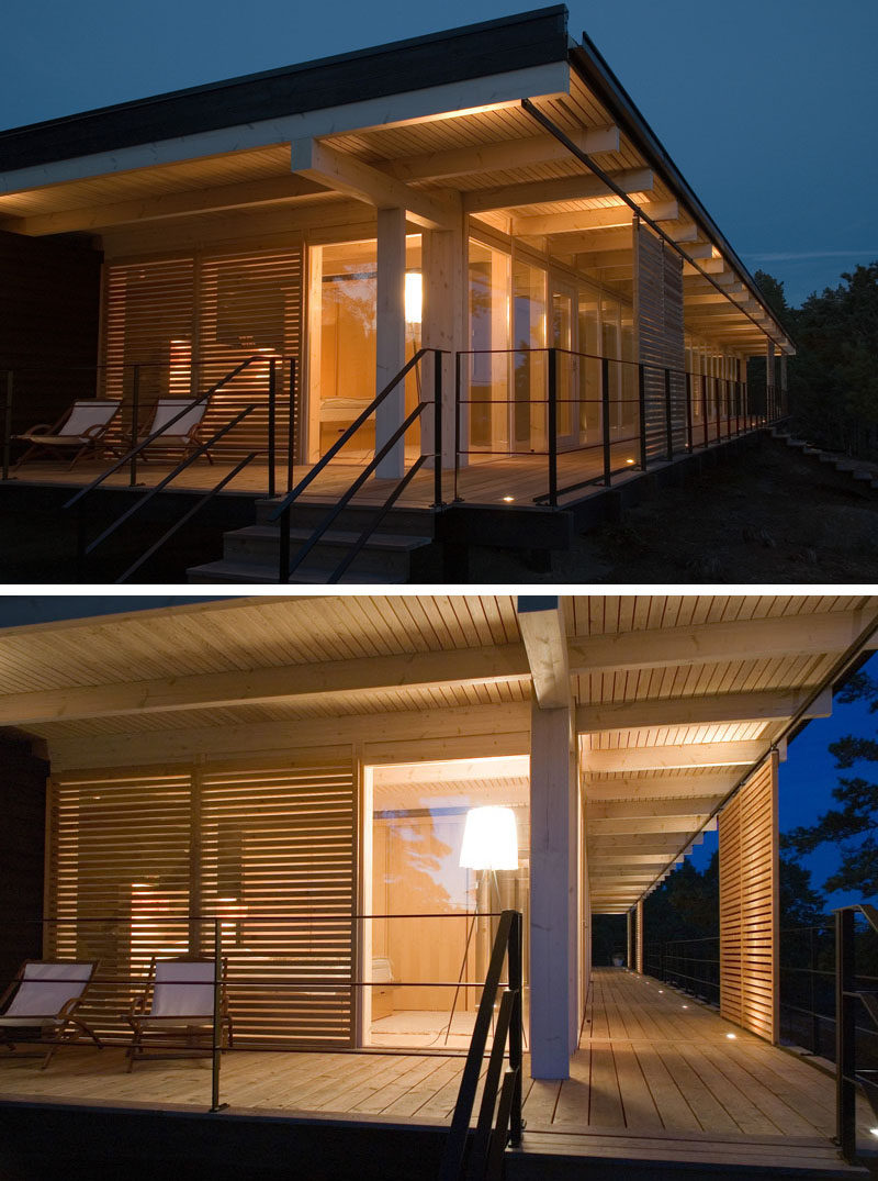 17 Inspiring Examples Where Exterior Uplighting Has Been Used To Show Off A House //The small lights along the deck of this cottage brighten the exterior, and make entertaining into the evening easy and fun.