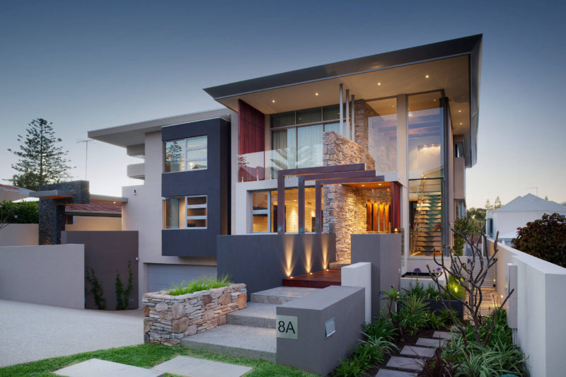 17 Inspiring Examples Where Exterior Uplighting Has Been Used To Show Off A House // Built in lights guide people into this home and cast unique shadows on the walls leading up to the front door.