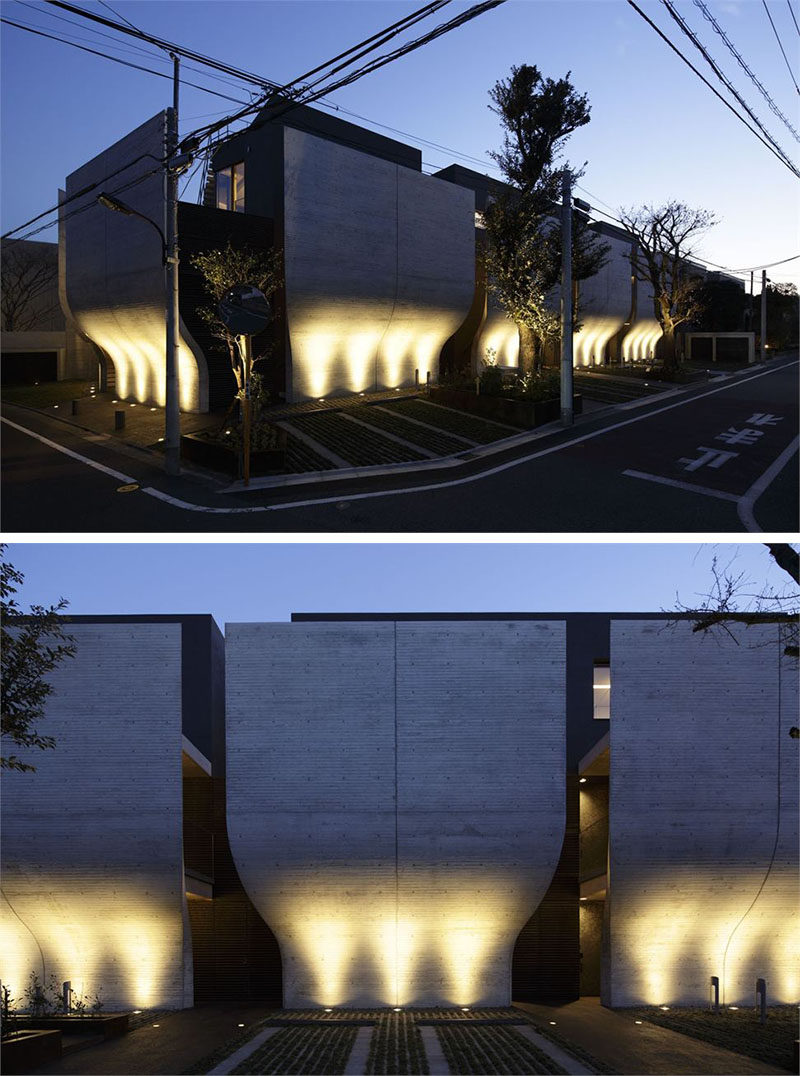 17 Inspiring Examples Where Exterior Uplighting Has Been Used To Show Off A House // Lights beneath the curved walls of this home emphasize the unique outer design of the home and brighten the entire exterior.