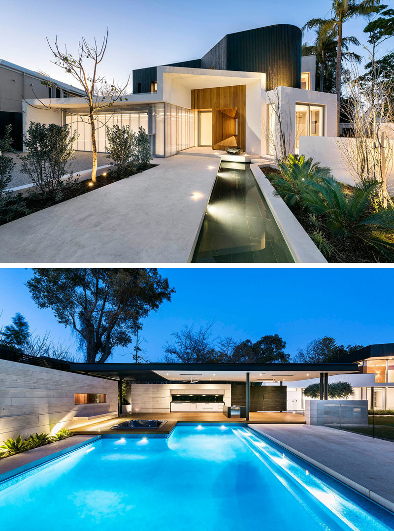 17 Inspiring Examples Where Exterior Uplighting Has Been Used To Show Off A House // Lights placed throughout both the front and back yards of this home, illuminate pathways and create dramatic lighting around the plants and trees.
