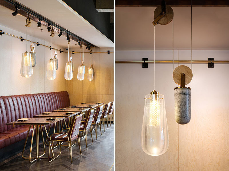 This Restaurant Is Filled With Pendant Lighting On A Pulley System