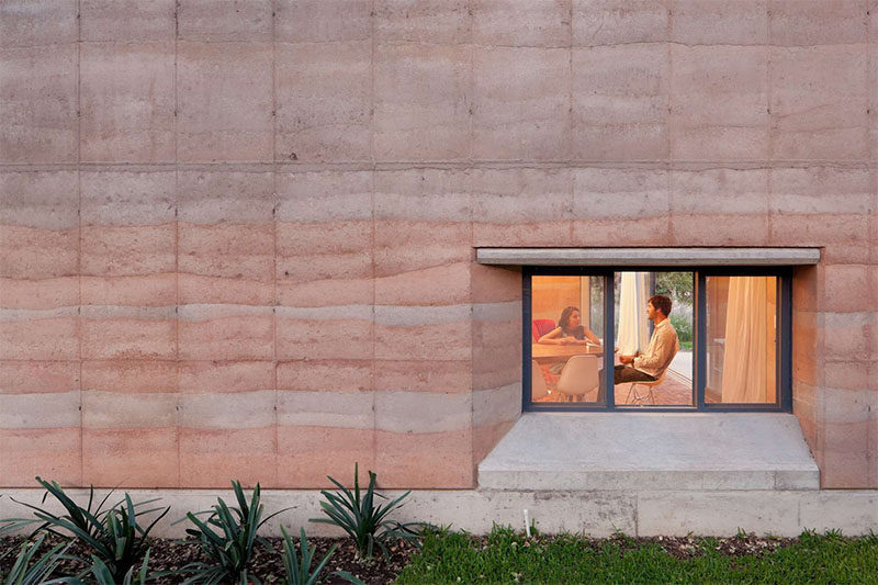 A modern house with rammed earth walls