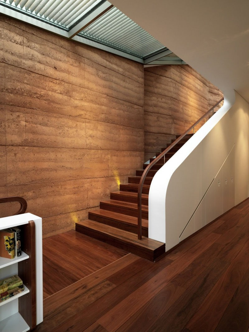 Rammed earth wall with a natural finish.