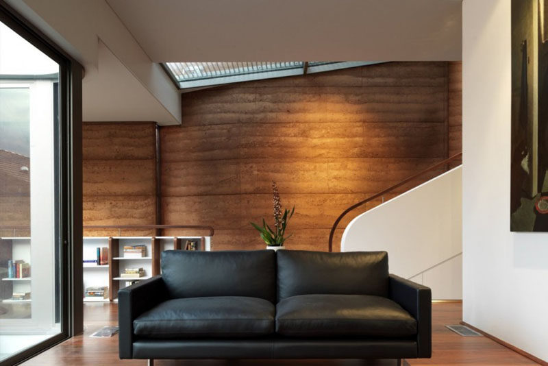 A natural brown rammed earth wall.