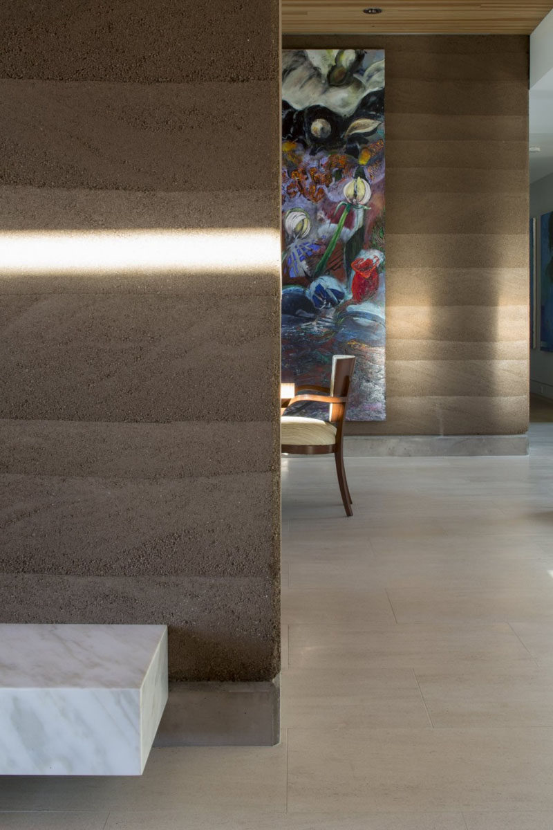 A rammed earth wall with different natural layers.