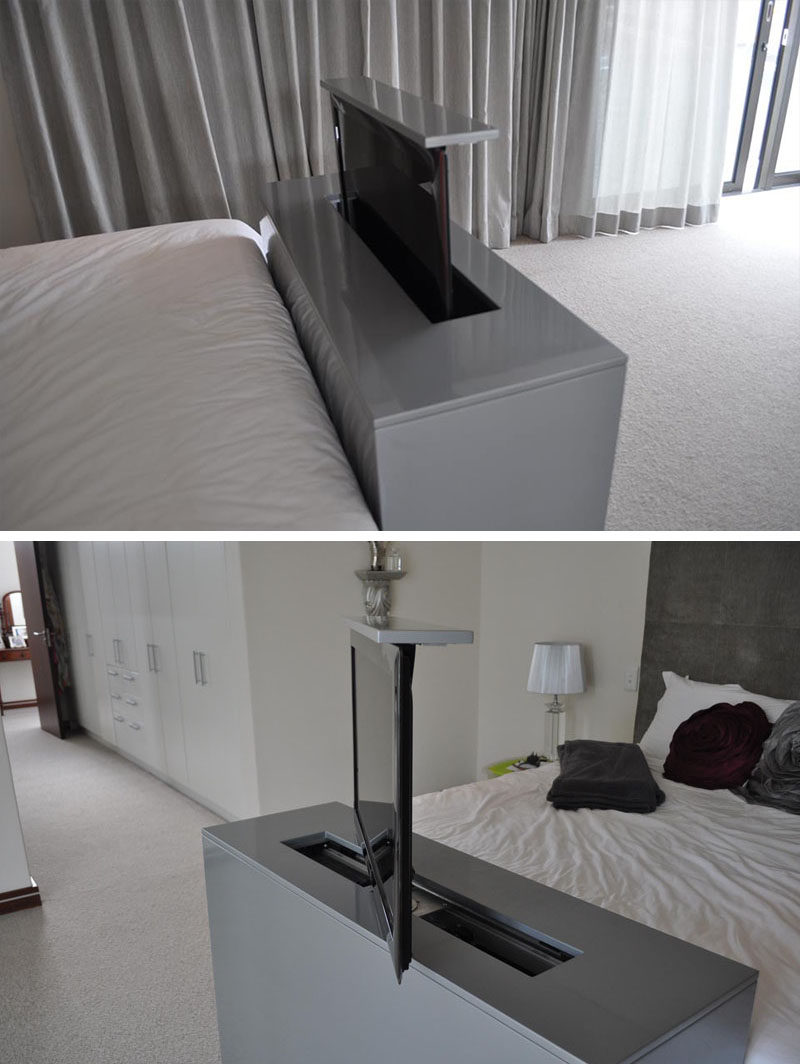The TV built into the foot of this bed rises up and swivels to allow for bed viewing as well as viewing from any other angle in the bedroom.