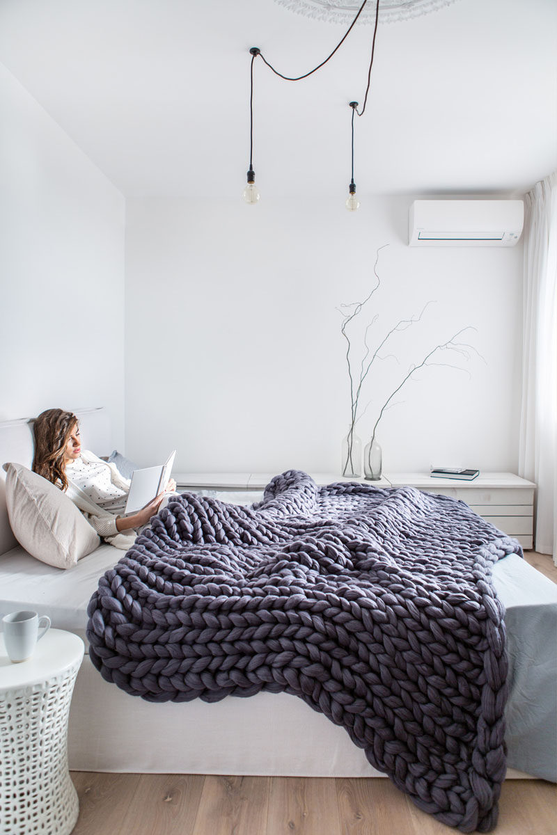 10 Key Features Of Scandinavian Interior Design // Cozy Textiles -- Scandinavian design may not use a ton of blankets or pillows to decorate, but the ones that do get included are sure to double as both a functional and cozy provider of warmth as well as a stylish way to add texture when it's not being used.
