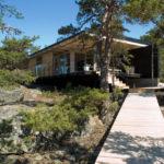 A Small Contemporary Cabin Designed For A Rocky Coastline