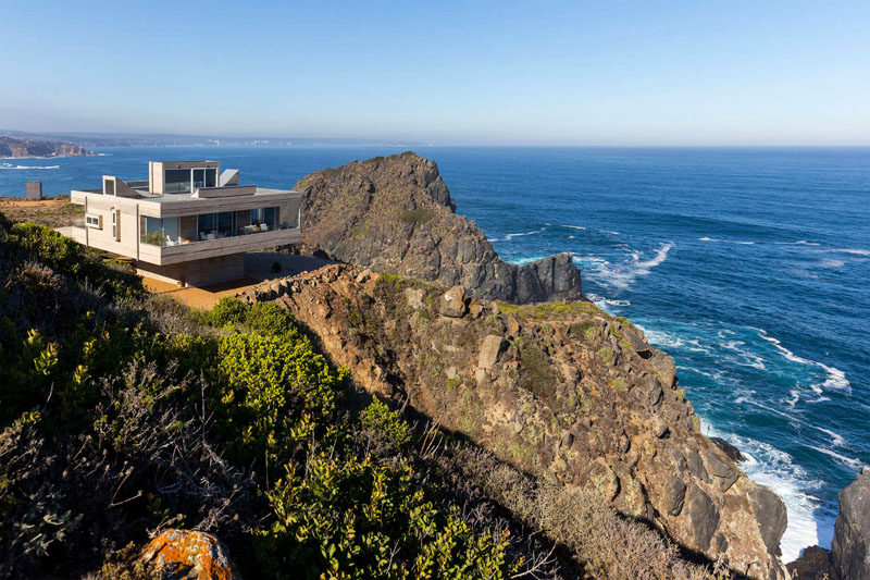 13 Totally Secluded Homes To Escape From The World // Perched above a steep cliff with views of the ocean, this secluded home is in Tunquén, Chile.