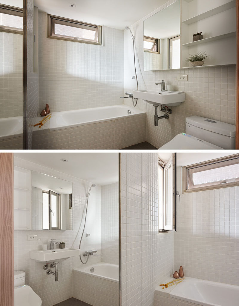 In this bathroom, white is the key design element, helping to keep the space bright and airy. Two mirrors also help to reflect the light, and make the space appear larger than it is.