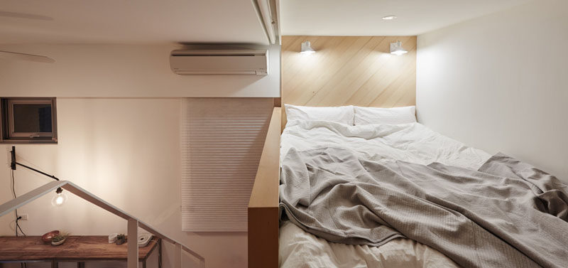 This small bed is located on a mezzanine level in this tiny apartment.