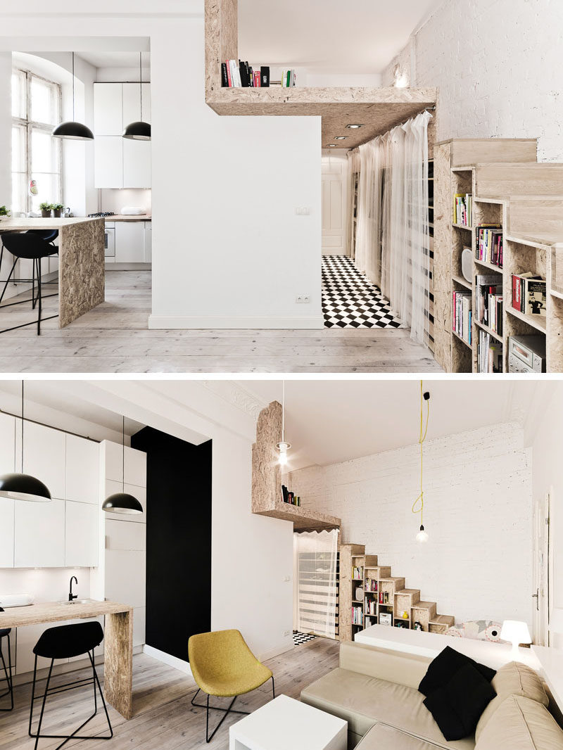 This small apartment is just 312 square feet, and it includes a lofted bedroom, stairs with storage and a well-designed kitchen that makes use of the height of the apartment.