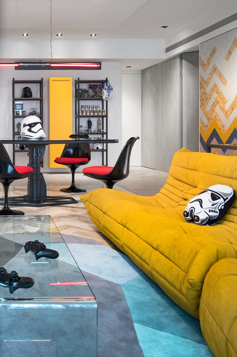 In this Star Wars inspired apartment, elements like lightsabers and Darth Vader cushions, have been used as pendant lights and decorative elements.