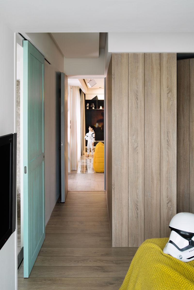 A sliding wooden door has been painted pastel blue.