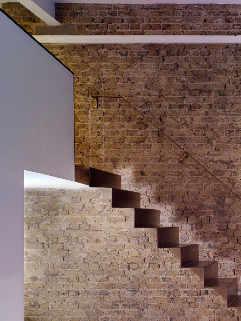 As part of the refurbishment of an apartment in Hackney, North London, Bell Phillips Architects designed minimalist stairs made from 6mm thick folded steel.