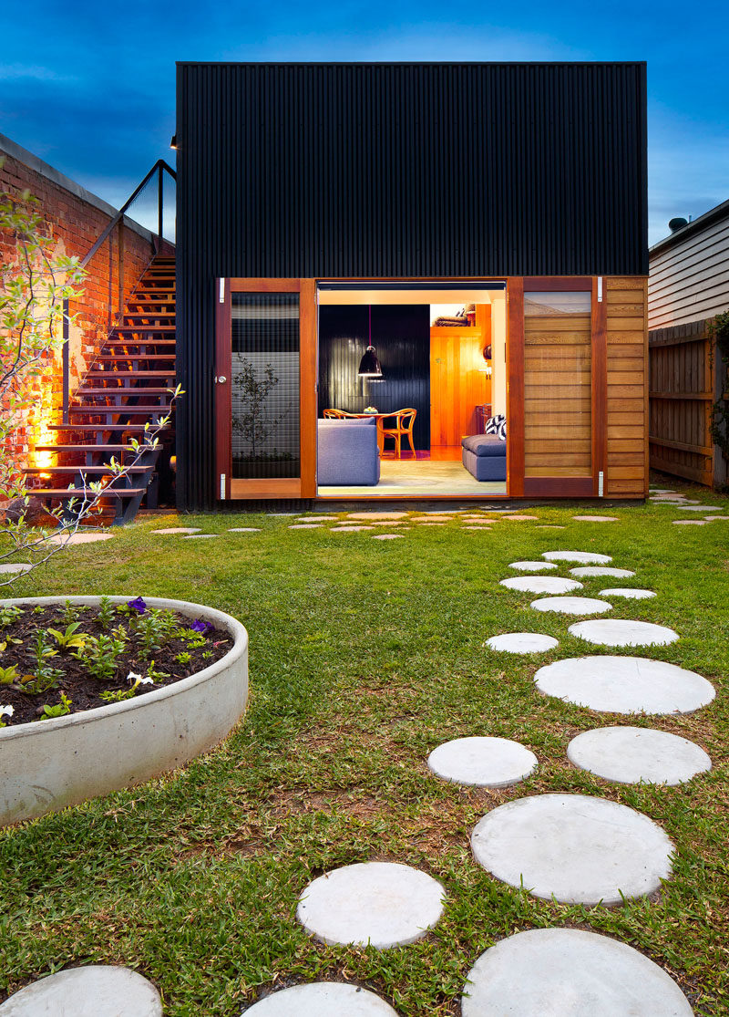 10 Ideas for Stepping Stones in Your Garden // Round stepping stones scattered throughout the yard of this home create paths and fun places to practice hopscotch skills.